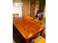 Solid pine table and six chairs for sale
