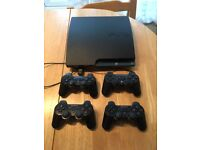 PS3 Slim 250 GBs with 4 game controls and 13 games