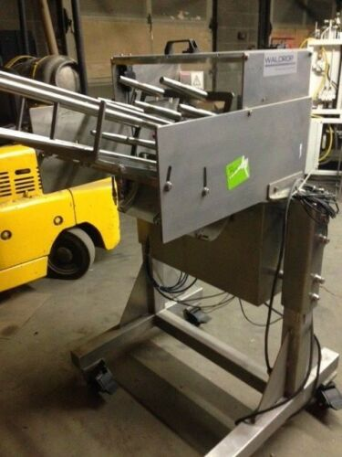 Waldrop blister tray feeder for conveyor