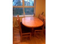 Great condition solid extendable Kitchen dinning table and six chairs