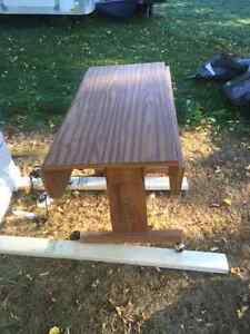 Dining table converts to coffee table with extenders