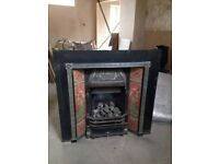 Price reduced !!!! complete cast iron gas fireplace including a black tiled hearth.