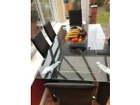 BROWN GLASS DINNING TABLE WITH DOUBLE LAYER PLUS 6 HIGH BACK CHAIRS. STYLISH DESIGN. GOOD CONDITION