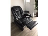 Black massaging chair with remote control