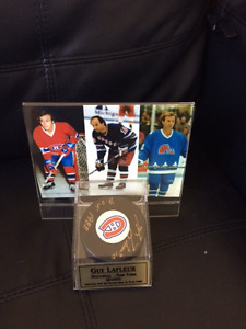 Guy Lafleur signed hockey puck and pictures in display case.