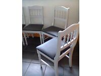 6 painted kitchen chairs for sale. Pale grey with black padded seat.