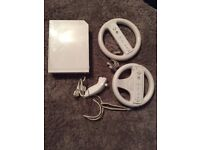 Nintendo Wii with 2x Wii remotes and 2x Mario Kart wheels steering wheels