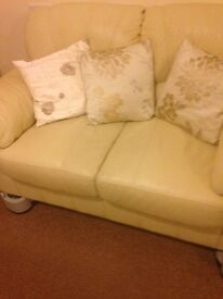 Beige leather double seater and single seater sofa in good condition