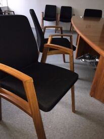 8 wooden office chairs, black padded material