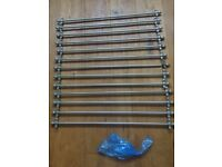 A set of stair rods with cone finials