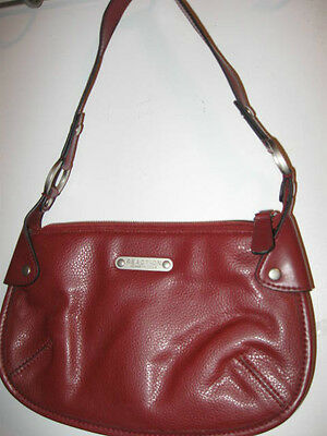 Preowned Small REACTION Kenneth Cole PURSE has inside zipper pocket red