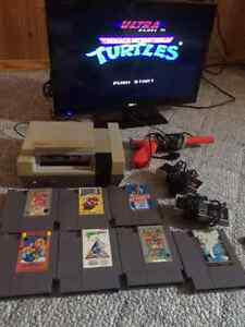 NES Nintendo Console with 9 games