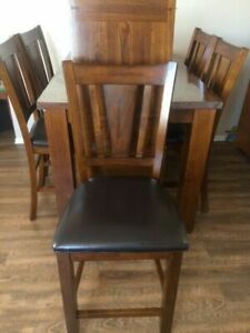 Like new solid wood dining table with 8 leather chairs