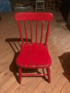 Red older wooden chair