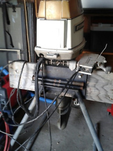 55 H.P. Evinrude c/w controls and outboard motor stand.