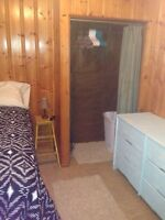 Room in shared home w/own bathroom/living room - Great location!