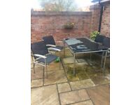 Black Granite and Stainless Steel Patio Set