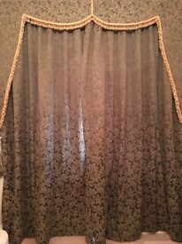Green and gold curtains with pelmet and curtains ties
