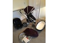 Beautiful Silver Cross Surf 2 travel system and Simplicity car seat in aubergine