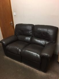 Two Brown Leather reclining sofa's