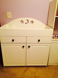 Beautiful Baby Change Table with clothing cupboard.