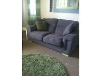 Scs 2 seater grey sofa and 2 foot stools