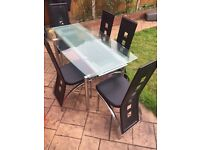 Harvey's glass dining table and chairs