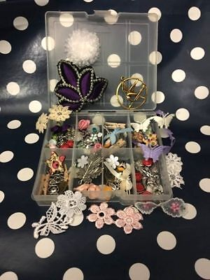 Little box full of craft charms and embellishments