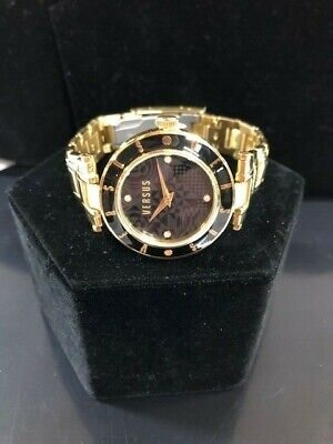 Versus by Versace SP811 0014 Ladies Gold Tone Watch w/ Black Accents