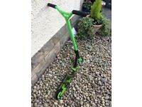 Used Vokul Sport Stunt Scooter. Green and black two wheeler.