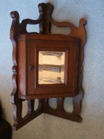 Attractive Antique Mahogany Corner Cabinet with hinged Mirrored Door