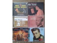 A collection of 7 Mel Torme CDs