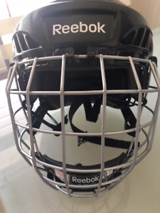 Almost new Youth size Reebok small/med Hockey Helmet with cage