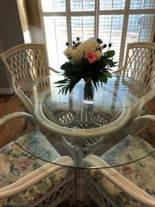 48' round bevelled glass top table and 4 chairs. Like new