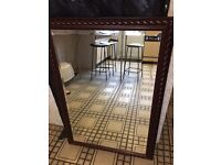 Large wood-framed mirror - good condition - space needed