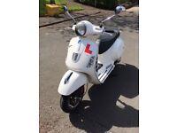 White Vespa GTS Super 125