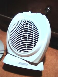 Garrison oscillating room heater ,1500 and 700watts  call or tex