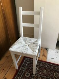 White wooden and wicker chair