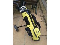 Children's golf clubs and trolley