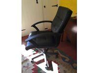 Black swivel Office Chair in faux leather. Adjustable. 5 spoke leg on casters. H36in W23in D19in