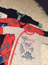 Bundle of baby clothes - newborn