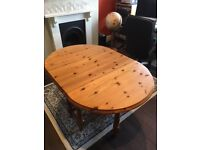 Medium/Small Pine Gate-leg style oval table and 4 pine chairs for sale