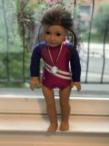 Two American girl doll leotards with scrunchies and a metal