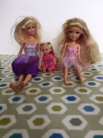 Barbie and two extra dolls