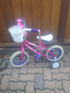 "Girls 12"" bike with training wheels"