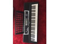 "Yamaha Keybard YPT 210 Length 36"" 61 keys complete with book stand + plug - for children or learners"
