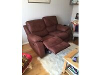 2 seater faux suede recliner sofa. Colour chocolate. Only 1 year old and in excellent condition