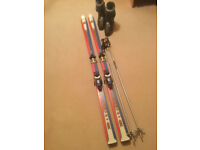 Men's ski boots (size 10), skis and poles.