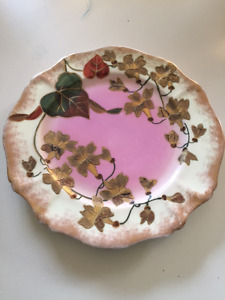 Pink, gold and off white plate with raised leaf design