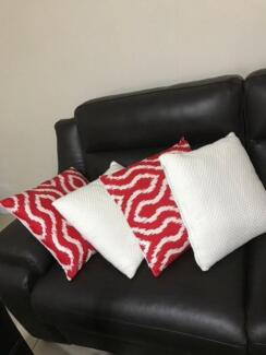 4 x cushions, all excellent condition 2 x white and 2 x Red print